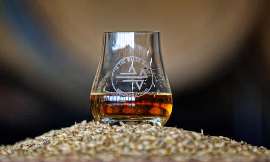 A whisky glass on the locally grown barley used to make the new whisky.