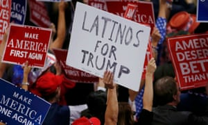 A person holds a sign reading Latinos for Trump on the third day of the Republican National Convention in Cleveland, Ohio, on 20 July 2016.