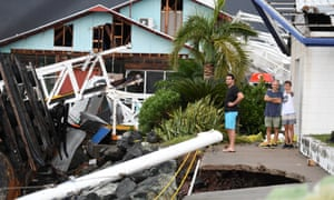 Locals inspect damage caused by Cyclone Debbie to the marina at Shute Harbour, near Airlie Beach