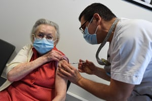 A resident of a retirement home receives a dose of the Pfizer/BioNtech Covid-19 vaccine in Loos, northern France