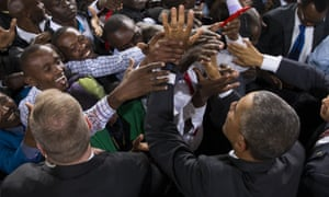 Obama shakes hands with supporters after delivering a speech in Nairobi.