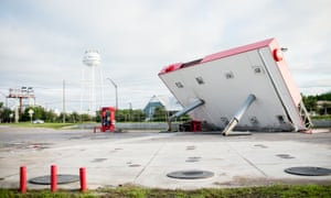 The overhang of a gas station is toppled over in the aftermath of Hurricane Michael in Inlet Beach, Florida.