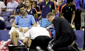 Novak Djokovic receives treatment on his foot during a medical time out.