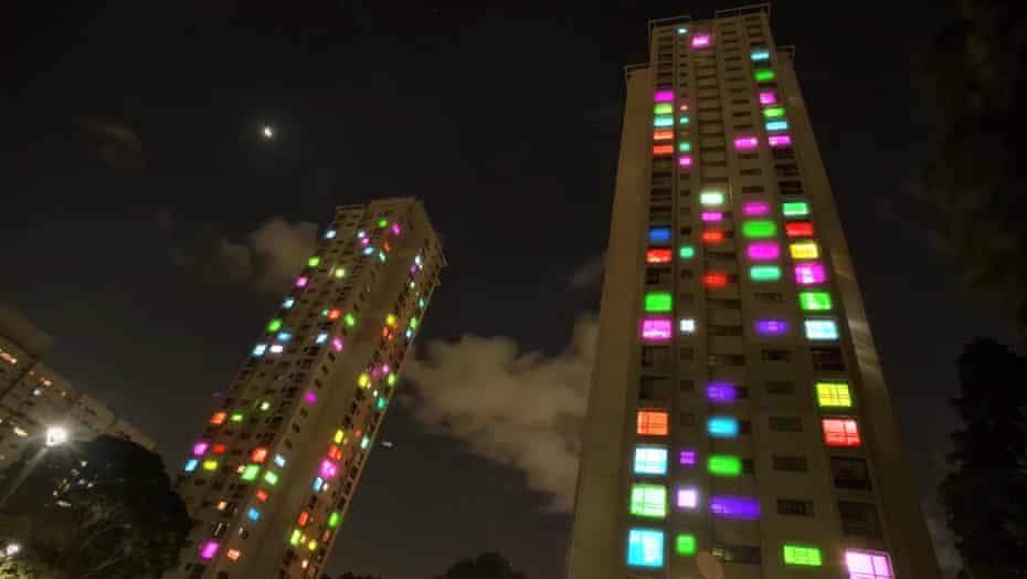 Matavai and Turanga public housing towers are lit up as part of the We Live Here highrise community light project
