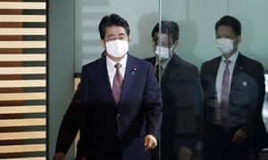 Shinzo Abe arrives for his final cabinet meeting in Tokyo on Wednesday before Yoshihide Suga is confirmed as the next prime minister of Japan.