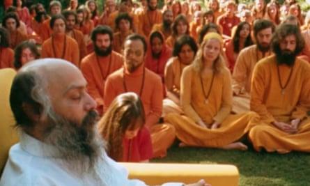 Bhagwan Shree Rajneesh with his followers in Rajneeshpuram, Oregon, as seen on the Netflix series Wild Wild Country.