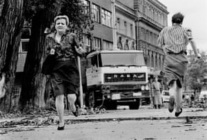 Women brave Sarajevo's 'Sniper Alley' in 1992. The Bosnian capital was under siege for four years during the Yugoslav wars.