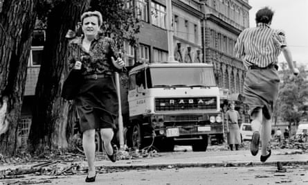 Women run for their lives across 'Sniper Alley' under the sights of Serb gunmen during the siege of Sarajevo. 1992.