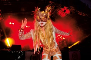 Shangri La is a festival of contemporary performing arts held each year within Glastonbury Festival. The theme for the 2015 Shangri La was Protest. Girl in costume and mask dancing on the Hell stage