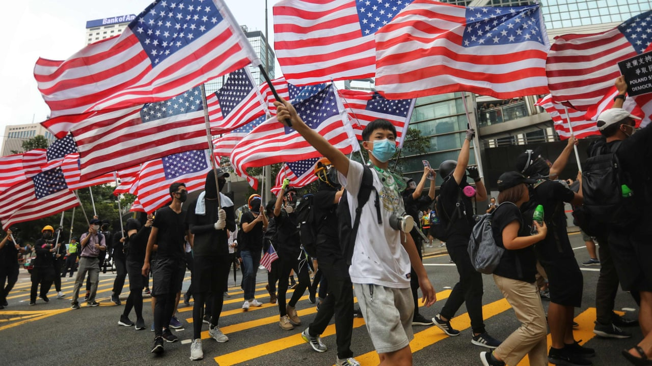 Protesters in Hong Kong march to US consulate calling for Trump's support –  video