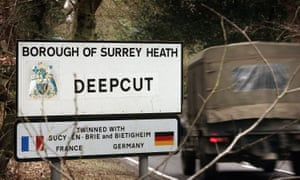 Deepcut roadsign, with British army vehicle driving by