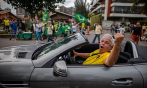 Supporters of Bolsonaro cheer in front of the residential condominium where he lives, in Barra da Tijuca, in Rio de Janeiro.
