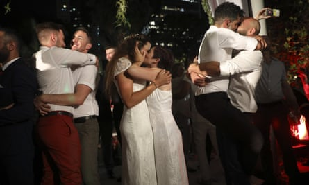 The gay couples participated in a mass wedding in Tel Aviv to demand the right to same-sex marriage.