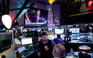 Traders on the New York stock market as Federal Reserve Chairman Jerome Powell gives a press conference following the the announcement of the Federal Reserve's decision to raise interest rates