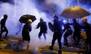 Anti-government protesters clash with the police outside the Polytechnic University in Hong Kong.