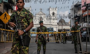 Police guard the area near St Anthony's Shrine in Colombo where at least 15 people died in the Easter Sunday attacks.