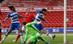 The ball is heading into the Reading net via either Reading's Tom Holmes or Forest's Glenn Murray.