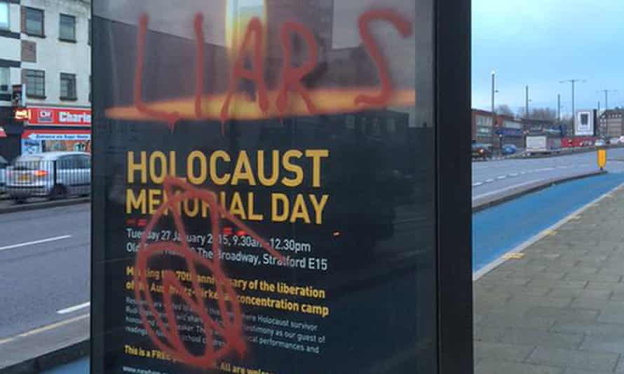 Graffiti on posters advertising Newham council's Holocaust Memorial Day event in Stratford, London in January 2015.