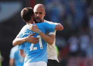 Guardiola hugs Silva after City's 3-1 win.