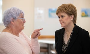 Nicola Sturgeon (right) with Janet Brown during a visit to the Lochside Community Centre in Dumfries yesterday.