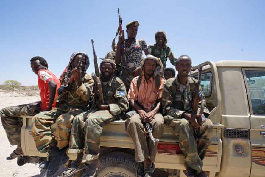 A local security team who operate alongside UN and NGO aid workers in the remote desert town of Dinsoor