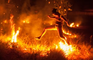 Controlling the fire in Slash and Burn agriculture, Central BrazilPeople from the Karajá tribe use Slash and Burn agriculture near the Araguaia River in Central Brazil. Here a girl has fun controlling the fire, running barefoot over the vegetation Photograph: Kristiaan D'Aout/GuardianWitness