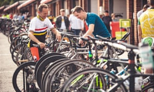 Ready to roll: Martin Love and bike builder Oli Laverack inspect bikes before the start of the race.