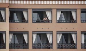 A man stands on a balcony of the H10 Costa Adeje Palace hotel in  Tenerife.