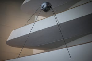 A replica of the Soviet Sputnik I satellite, the world's first spacecraft, hangs above the visitors' lobby