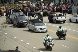 A silver hearse carrying the body of Nipsey Hussle leaves Staples Center Thursday in Los Angeles in a procession following the memorial service for the late rapper.