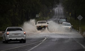 Water across the road causes traffic chaos on the Taree-Gloucester road outside Taree NSW. (The road is cut completely further down from this point) Sunday 21st March 2021. Photograph by Mike Bowers. Guardian Australia.