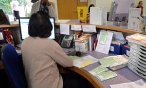 Receptionist sorting prescriptions at a GP surgery