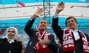 Recep Tayyip Erdoğan, center, and PM Ahmet Davutoğlu, right, and Emine Erdoğan