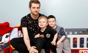 Gareth Gibson, 21, with his sons Ross and Oscar: 'I don't go out and see my mates as much, but it's not a big deal.'