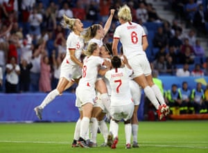 Lucy Bronze is mobbed by her teammates as they celebrate after her thumping shot put England three goals to the good.