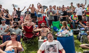 Race fans watch the 103rd race of the Indianapolis 500 at Indianapolis Motor Speedway in Indiana, US