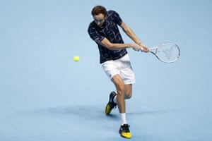 Daniil Medvedev returns the ball to Rafael Nadal.