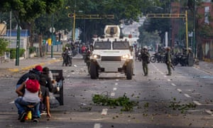 Demonstrators clash with police during protests in Caracas.