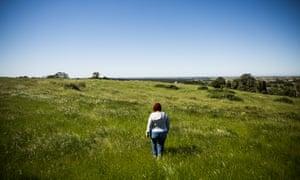 Tammi walks her land.