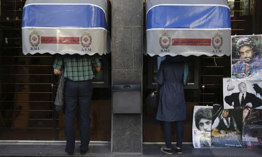 Iranians using Bank Melli Iran cash machines in Tehran