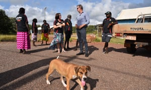 The Indigenous affairs minister, Nigel Scullion, with workers at a Community Development Program provider in Arnhem Land. A government review into the remote work-for-the-dole scheme has released damning findings.
