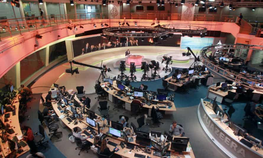 Staff inside the Al Jazeera global headquarters in Doha, Qatar.