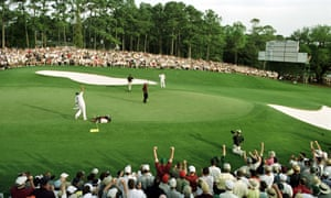 Tiger Woods of the US celebrates after winning the Masters on the 18th green during the final day of the 2001 Masters.