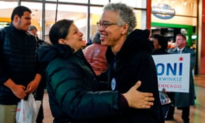 Chicago mayoral candidate Toni Preckwinkle, right, greets a commuter during her final campaign stop at the Thompson Center in Chicago on Tuesday.
