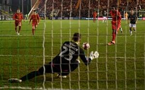 Liverpool's Divock Origi has his penalty saved by Plymouth Argyle's Luke McCormick.