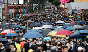 Protesters against the proposed extradition bill march in Mongkok, Hong Kong on Saturday