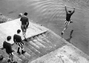 Docherty jumps into the sea during a Chelsea team training day at Blackpool