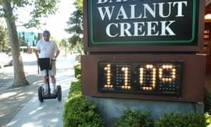 Mike Dupray rides his Segway scooter through town during a record-breaking heat wave in Walnut Creek, Calif., Saturday, July 22, 2006.