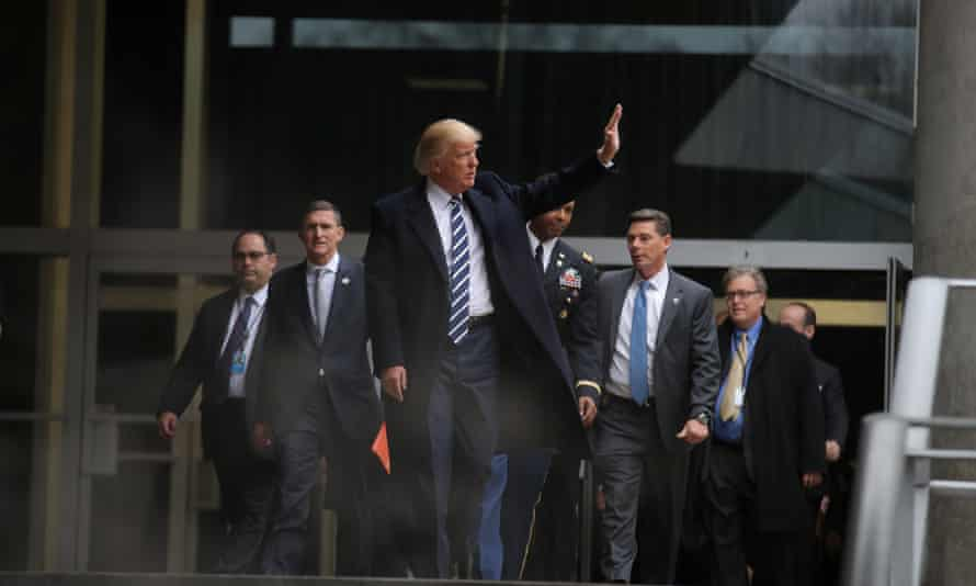 Donald Trump waves as he leaves CIA headquarters in Langley, Virginia on 21 January 2017.