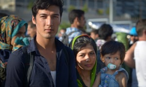 An Afghan family arrive at the port of Piraeus.